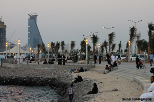 Families enjoying the sea breeze at the Jeddah Corniche.