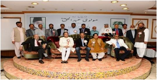 On stage from left: V.P. of Aalmi Urdu Markaz, Rohail A. Khan, Hon. Tahseem ul-Haq, President of Aalmi Urdu Markaz and poet Anwar Ansari with the Executive Team from Aalmi Urdu Markaz.